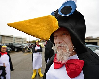 YOUNGSTOWN, OHIO - OCTOBER 28, 2017: Clovis Linkous, a professor in the YSU chemistry department, stands near the parade route waiting for the start of the YSU homecoming parade, Saturday afternoon. DAVID DERMER | THE VINDICATOR