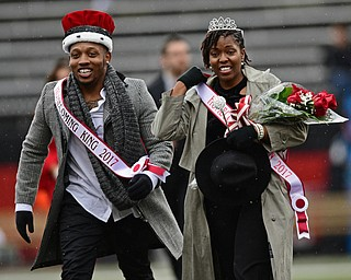 YOUNGSTOWN, OHIO - OCTOBER 28, 2017: Youngstown State students Willie Parker and Tierney McCaster smile after being crowned homecoming king and queen during a halftime ceremony during a game between the Youngstown State Penguins and Illinois State Redbirds, Saturday afternoon at Stambaugh Stadium. Illinois State won 35-0. DAVID DERMER | THE VINDICATOR