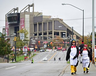 YOUNGSTOWN, OHIO - OCTOBER 28, 2017: Ashley Milligan and Brad Smith, both from Canfield, walk down Fifth Avenue near the parade route waiting for the start of the YSU homecoming parade, Saturday afternoon. DAVID DERMER | THE VINDICATOR