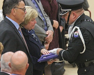 William D Lewis The vindicator An honor guard member presents folded flag from casket of slain Giard police officer Justin Leo to his parents David and Pat Leo.