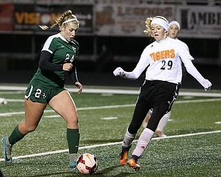 Elyria Catholic midfielder Makenna Hodges (24) drives towards the net as Springfield Local midfielder Anna Rothwell (29) tries to steal the ball away during the first half as Elyria Catholic High School takes on Springfield Local High School in the Division III Region 9 Regional Semi-Finals, Tuesday, Oct. 31, 2017, at Green Memorial Stadium in Uniontown. Elyria won 6-0...(Nikos Frazier | The Vindicator)..