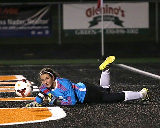 Springfield Local goalie Lex Slike (11) watches the ball before it is kicked into the net by Elyria Catholic forward Delaney Stringer (37) during the first half as Elyria Catholic High School takes on Springfield Local High School in the Division III Region 9 Regional Semi-Finals, Tuesday, Oct. 31, 2017, at Green Memorial Stadium in Uniontown. Elyria won 6-0...(Nikos Frazier | The Vindicator)..