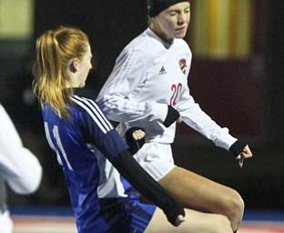 William D. Lewis the Vindicator  Canfield's Camryn Kohout(20) and Revere's Amanda Nelson(11) during 10312017 action at Ravenna.