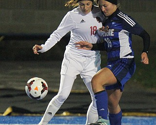 William D. Lewis the Vindicator  Canfield's Macey Malinki(18) and Revere's Nicole Langenfield(19) during 10312017 action at Ravenna.