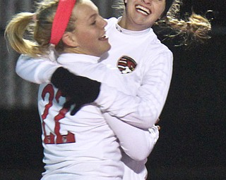 William D. Lewis the Vindicator  Canfield's Chloe Kalina(22) gets congrats from Morgan Carey(9) after scoring during 10312017 action at Ravenna.