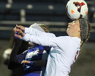 William D. Lewis the Vindicator  Canfield's Marisa Scheetz(5) heads the ball during 10312017 action at Ravenna.