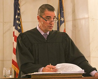 ROBERT K. YOSAY  | THE VINDICATOR..Judge Robert N Rusu Jr..A young girl found a new home as Judge Robert N. Rusu of Mahoning County Probate Court presided over her adoption in the courthouse rotunda during the countyÕs fourth Adoption Day celebrationÓ ...-30-