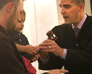 ROBERT K. YOSAY  | THE VINDICATOR..Judge Robert N Rusu Jr Jacqueline  Rose Wolfe and her dad  Shawn..A young girl found a new home as Judge Robert N. Rusu of Mahoning County Probate Court presided over her adoption in the courthouse rotunda during the countyÕs fourth Adoption Day celebrationÓ ...-30-