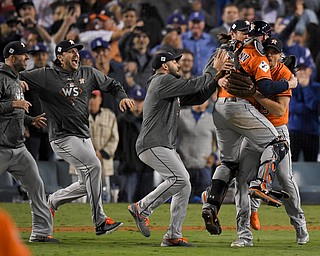 Members the the Houston Astros celebrate their win against the Los Angeles Dodgers in Game 7 of baseball's World Series Wednesday, Nov. 1, 2017, in Los Angeles. (AP Photo/Mark J. Terrill)