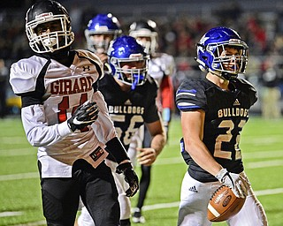 CORTLAND, OHIO - NOVEMBER 3, 2017: Lakeview's Evan Adair, right, celebrates after scoring a touchdown during the first half of the OHSAA playoff game, Friday night at Lakeview High School. DAVID DERMER | THE VINDICATOR..Girard's Terrance Davis pictured.