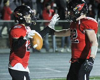 William D Lewis The Vindicator  Canfield's Paul French(27) gets congrats from Jacob Whittenberge(32) after scoring during 2nd qtr 11-3-17 playoff action with Aurora at Canfield.