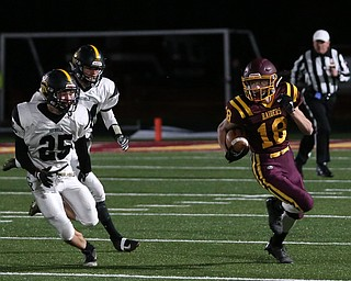 South Range's Mathias Combs(18) runs the ball as he looks at Crestview's Danny Moore(25) on the kickoff during the first quarter as Crestview High School takes on South Range High School, Friday, Nov. 3, 2017, at Raider's stadium at the Rominger Sports Complex in Canfield...(Nikos Frazier | The Vindicator)..