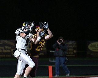 Crestview's Dylan Huff(9) and South Range's Josh Stear(20) go up for a pass intended for Huff in the endzone during the first quarter as Crestview High School takes on South Range High School, Friday, Nov. 3, 2017, at Raider's stadium at the Rominger Sports Complex in Canfield...(Nikos Frazier | The Vindicator)..