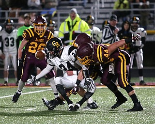 Crestview's Jeff Feo(24) fumbles the ball as the South Range defense tackles him from behind during the first quarter as Crestview High School takes on South Range High School, Friday, Nov. 3, 2017, at Raider's stadium at the Rominger Sports Complex in Canfield. South Range's Peyton Remish(44)...(Nikos Frazier | The Vindicator)..