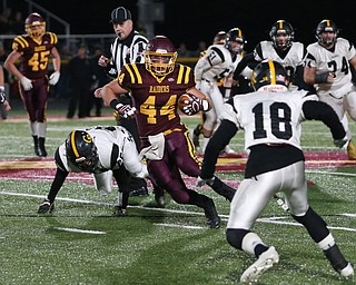 South Range's Peyton Remish(44) weaves to avoid Crestview's Austin Brodigan(18) during the first quarter as Crestview High School takes on South Range High School, Friday, Nov. 3, 2017, at Raider's stadium at the Rominger Sports Complex in Canfield...(Nikos Frazier | The Vindicator)..