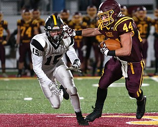 South Range's Peyton Remish(44) stiff arms Crestview's Stephen Barr(15) during the second quarter as Crestview High School takes on South Range High School, Friday, Nov. 3, 2017, at Raider's stadium at the Rominger Sports Complex in Canfield...(Nikos Frazier | The Vindicator)..
