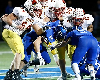 POLAND, OHIO - NOVEMBER 3, 2017:   Mooney's Andre McCoy (6) is tackled by Poland's Eric Shipsky (5) and Mike Voitus (88) during the1st qtr. at Bulldog Stadium. MICHAEL G TAYLOR | THE VINDICATOR