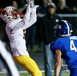 POLAND, OHIO - NOVEMBER 3, 2017:   Mooney's Nico Marchionda (5) catches a TD pass as Poland's Mike Diaz (4) defends during the 2nd qtr. at Bulldog Stadium. MICHAEL G TAYLOR | THE VINDICATOR