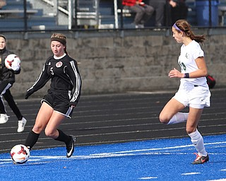 Canfield forward Marisa Scheetz (5) charges towards the goal as Lake Catholic defender Julia Marusic (18) chases on during the first half as Lake Catholic High School takes on Canfield High School in the Division II Regional Final, Saturday, Nov. 4, 2017, at Gilcrest Field at Portage Community Bank Stadium in Ravenna, Ohio. Lake won 2-0...(Nikos Frazier | The Vindicator)..