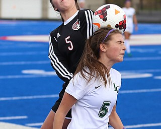 Canfield forward Marisa Scheetz (5) and Lake Catholic midfielder Kennedy Newhart (5) go up for the ball during the first half as Lake Catholic High School takes on Canfield High School in the Division II Regional Final, Saturday, Nov. 4, 2017, at Gilcrest Field at Portage Community Bank Stadium in Ravenna, Ohio. Lake won 2-0...(Nikos Frazier | The Vindicator)..