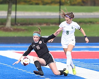 Canfield defender Ellie Accordino (16) is pushed down by Lake Catholic midfielder Kennedy Newhart (5) during the first half as Lake Catholic High School takes on Canfield High School in the Division II Regional Final, Saturday, Nov. 4, 2017, at Gilcrest Field at Portage Community Bank Stadium in Ravenna, Ohio. Lake won 2-0...(Nikos Frazier | The Vindicator)..