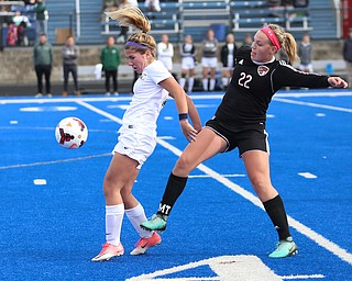 Lake Catholic midfielder Ali Morgan (7) and Canfield midfielder Chloe Kalina (22) fight for the ball during the first half as Lake Catholic High School takes on Canfield High School in the Division II Regional Final, Saturday, Nov. 4, 2017, at Gilcrest Field at Portage Community Bank Stadium in Ravenna, Ohio. Lake won 2-0...(Nikos Frazier | The Vindicator)..