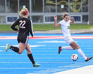 Lake Catholic defender Julia Marusic (18) reaches out for the ball as Canfield midfielder Chloe Kalina (22) nears during the first half as Lake Catholic High School takes on Canfield High School in the Division II Regional Final, Saturday, Nov. 4, 2017, at Gilcrest Field at Portage Community Bank Stadium in Ravenna, Ohio. Lake won 2-0...(Nikos Frazier | The Vindicator)..