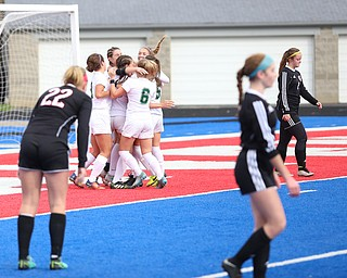 Lake Catholic forward Keka Babic (9) is congratulated by her teammates after scoring a goal during the first half as Lake Catholic High School takes on Canfield High School in the Division II Regional Final, Saturday, Nov. 4, 2017, at Gilcrest Field at Portage Community Bank Stadium in Ravenna, Ohio. Lake won 2-0...(Nikos Frazier | The Vindicator)..