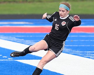 Canfield defender Ellie Accordino (16) kicks the ball away from the Canfield territory during the first half as Lake Catholic High School takes on Canfield High School in the Division II Regional Final, Saturday, Nov. 4, 2017, at Gilcrest Field at Portage Community Bank Stadium in Ravenna, Ohio. Lake won 2-0...(Nikos Frazier | The Vindicator)..