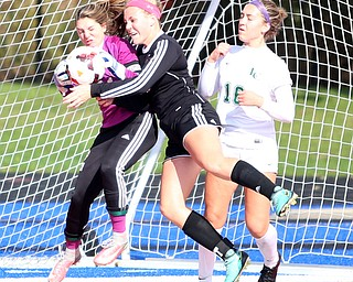Canfield defender Ally Stein (24) collides with Lake Catholic goalie Kennedy Solymosi (21) during the second half as Lake Catholic High School takes on Canfield High School in the Division II Regional Final, Saturday, Nov. 4, 2017, at Gilcrest Field at Portage Community Bank Stadium in Ravenna, Ohio. Lake won 2-0...(Nikos Frazier | The Vindicator)..