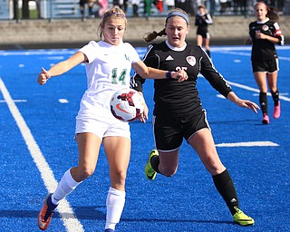Lake Catholic forward Grace Mohr (14) waits before kicking the ball away from Canfield do Hannah Stein (25) during the second half as Lake Catholic High School takes on Canfield High School in the Division II Regional Final, Saturday, Nov. 4, 2017, at Gilcrest Field at Portage Community Bank Stadium in Ravenna, Ohio. Lake won 2-0...(Nikos Frazier | The Vindicator)..