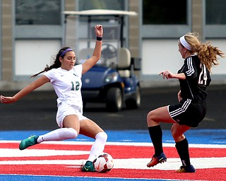 Lake Catholic midfielder Kati Druzina (12) attempts to kick the ball around Canfield defender Ally Stein (24) during the second half as Lake Catholic High School takes on Canfield High School in the Division II Regional Final, Saturday, Nov. 4, 2017, at Gilcrest Field at Portage Community Bank Stadium in Ravenna, Ohio. Lake won 2-0...(Nikos Frazier | The Vindicator)..