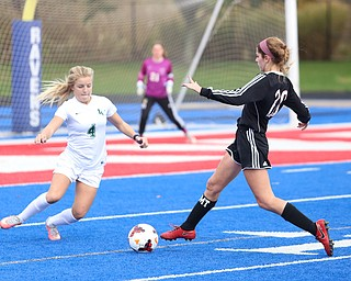 Canfield defender Camryn Kohout (20) goes up against Lake Catholic defender Kennedy Rieple (4) during the second half as Lake Catholic High School takes on Canfield High School in the Division II Regional Final, Saturday, Nov. 4, 2017, at Gilcrest Field at Portage Community Bank Stadium in Ravenna, Ohio. Lake won 2-0...(Nikos Frazier | The Vindicator)..