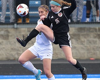 Canfield defender Ellie Accordino (16) kicks the ball as she clears Lake Catholic forward Keka Babic (9) during the second half as Lake Catholic High School takes on Canfield High School in the Division II Regional Final, Saturday, Nov. 4, 2017, at Gilcrest Field at Portage Community Bank Stadium in Ravenna, Ohio. Lake won 2-0...(Nikos Frazier | The Vindicator)..