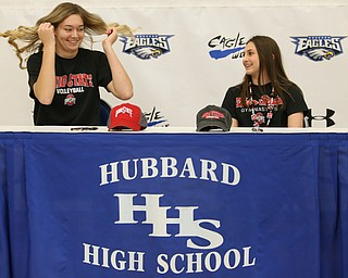 Adria Powell(left) and Claire Gagliardi sign their letters of intent for Ohio State University, Wednesday, Nov. 8, 2017, in the Hubbard High School Gymnasium in Hubbard. Gagliardi and Powell are both attending Ohio State University, playing gymnastics and volleyball respectively...(Nikos Frazier | The Vindicator)