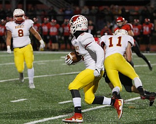 ROBERT K YOSAY  | THE VINDICATOR..CM #5  Nico Marchionda looks up field after intercepting a pass in the first quarter. .CM #11 Brent Weaver throwing a block and  #8CM  Brennan Olesh looks on..Cardinal Mooney vs Steubenville Big Red at Salem Stadium...-30-