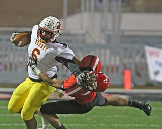 ROBERT K YOSAY  | THE VINDICATOR..CM #6  Andre McCoy  stiff arms SBR Javon Davis as he comes out of the back field during first half action at Cardinal Mooney vs Steubenville Big Red at Salem Stadium...-30-