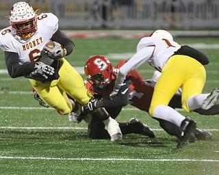 ROBERT K YOSAY  | THE VINDICATOR..CM# #6 breaks a tackle from SBR  #14Randy Mitchell as  CM#12 John Murphy - during first half action..Cardinal Mooney vs Steubenville Big Red at Salem Stadium...-30-