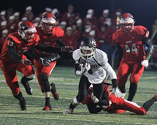 he Vindicator  Girard's Aidan Warga(4) ) eludes a host of Perry defenders during 1rst half action at Twinsburg.