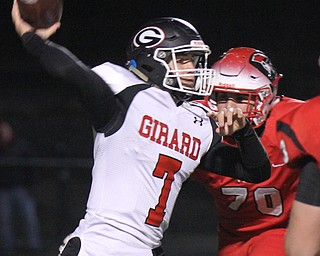 he Vindicator  Girard's Mark Waid(7) eludes Perry's Hayden Makad(704) during 1rst half action at Twinsburg.