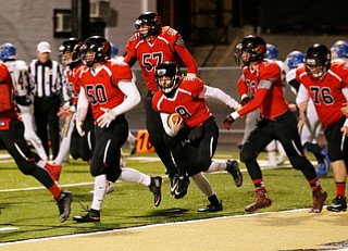 WARREN, OHIO - NOVEMBER 10, 2017:  Canfield's Nick Ieraci (9) celebrates with his teammates a 2pt conversion during the 1st qtr. at Harding High School, Mollenkopf Stadium.  MICHAEL G TAYLOR | THE VINDICATOR