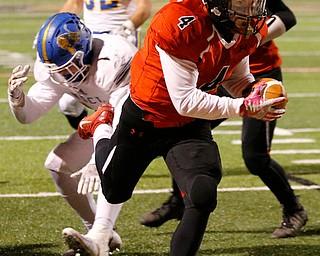 WARREN, OHIO - NOVEMBER 10, 2017:   Canfield's Paul Breinz (4) scores a 5 yard TD during the 4th qtr. at Harding High School, Mollenkopf Stadium.  MICHAEL G TAYLOR | THE VINDICATOR