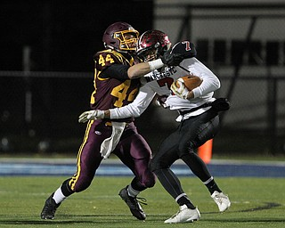 Peyton Remish (44) of South Range wraps up Ethan Wright (7) of Manchester during the first half of Friday nights matchup at Louisville High School in Louisville.  Dustin Livesay  |  The Vindicator  11/10/17  Louisville.