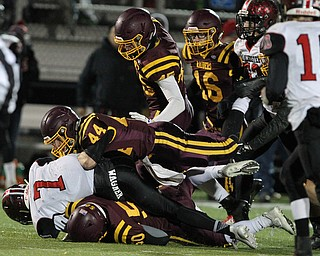Ethan Wright (7) of Manchester gets driven backward by a group of South Range defenders during the first half of Friday nights matchup at Louisville High School in Louisville.  Dustin Livesay  |  The Vindicator  11/10/17  Louisville.