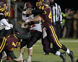 Peyton Remish (44) of South Range wraps up Hunter Foster (34) of Manchester during the first half of Friday nights matchup at Louisville High School in Louisville.  Dustin Livesay  |  The Vindicator  11/10/17  Louisville.
