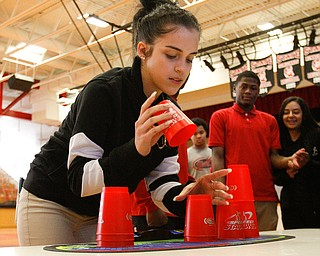 ROBERT K YOSAY  | THE VINDICATOR..Isabella Michelini  grade 9   on her timed part of the stacking..Students from freshmen to seniors spent part of their Thursday in the schoolÕs gym, stacking up and breaking down plastic Òsport stacking cupsÓ as part of this yearÕs ÒStack Up!Ó event, where participants from around the world attempted to set the record for most sport stackers competing in a single day..-30-