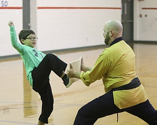 ROBERT K YOSAY  | THE VINDICATOR..Master Justin Taylor Jr., a Taekwondo master  is teaching elementary kids the basics of the martial art this week and how to get along...Mikey Zoccali..  gets ready to break a board.....-30-