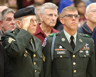 ROBERT K YOSAY  | THE VINDICATOR..honored vets at Boardman Glenwood Jr High salute the entry of the flags by students...Paul Eicher and  Keith Colovos  both  served in the Army..at Boardman although veterans day isn't till tomorrow. area schools honored  vets with songs or breakfast and shows......-30-