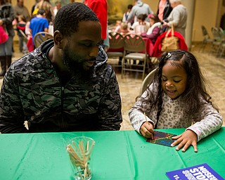 Five-year-old Ava Wise of Camel works on her scratch art, next to her dad, Justin at the Butler Institute of American Art museum Family Fun Day on Sunday in Youngstown.
