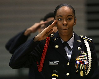 Cadet Cpt. Rosezena Figueroa salutes during a J.R.O.T.C drill practice, Thursday, Nov. 16, 2017, at East High School in Youngstown...(Nikos Frazier | The Vindicator)